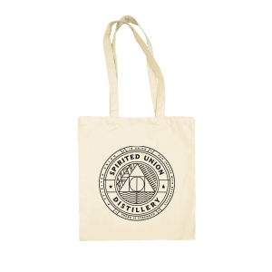 witte canvas tas met Spirited Union Distillery logo