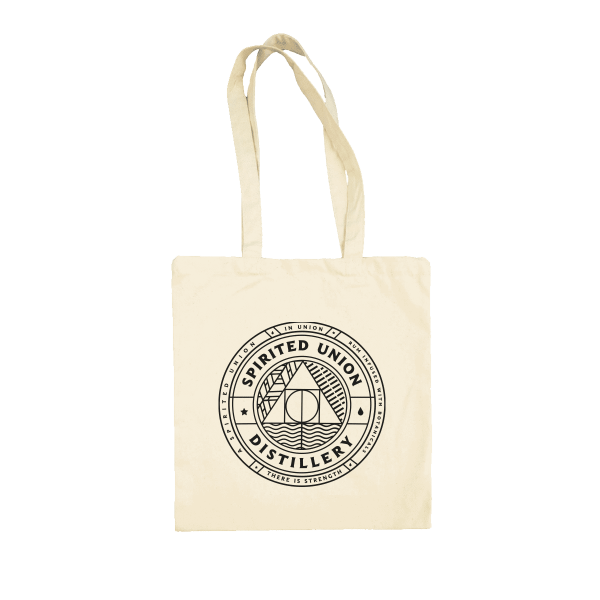 white tote bag with spirited union distillery logo