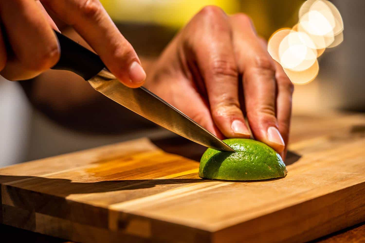 Slicing lime on cutting board