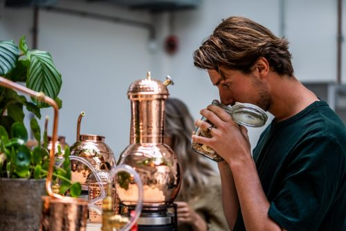 Smelling botanicals during distilling class